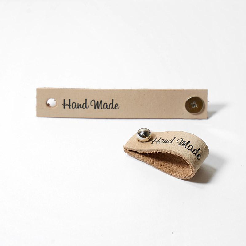 Кожаная бирка Hand Made с кнопкой 1,3х7см бежевый