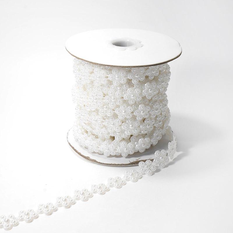 Фигурные бусины на нити 11мм 9,14м цветок белый