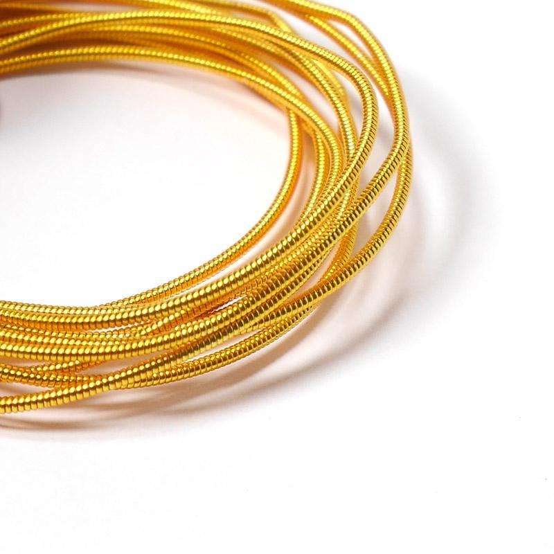 Канитель 1,25мм 1442-EMB т.золото жесткая 5гр